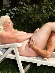 Fat blonde facesits skinny boy outdoors