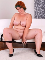 Sweet tattooed plumper takes all her clothes off